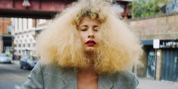 Woman with blonde afro