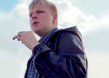 Man with blonde hair leather jacket smoking