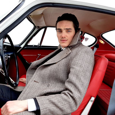 Cool man sitting in classic car