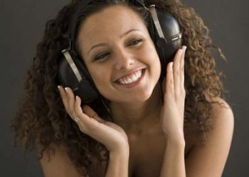 Girl smiling with large headphones