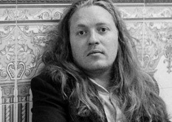 Black and white man with long hair