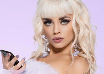 Blonde girl makeup holding phone
