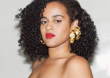 Black girl with gold earings curly hair