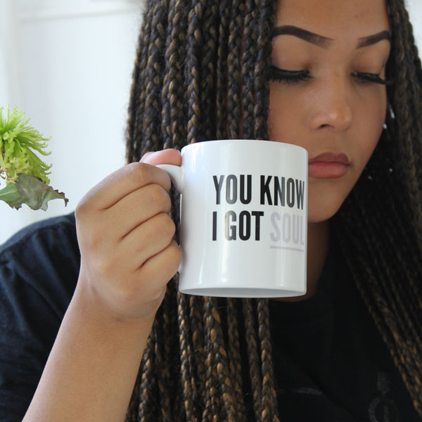 Girl holding mug with text design