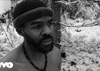 Black man shirtless in the snow