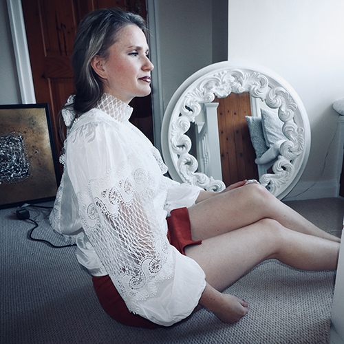Woman on the floor with vintage mirror