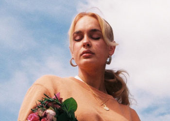 Blonde Swedish woman with flowers