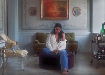 Sad girl sitting in large house