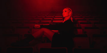 Red filter of blonde woman