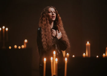 Woman surrounded by candles