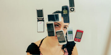 Girl surrounded by phones in the air