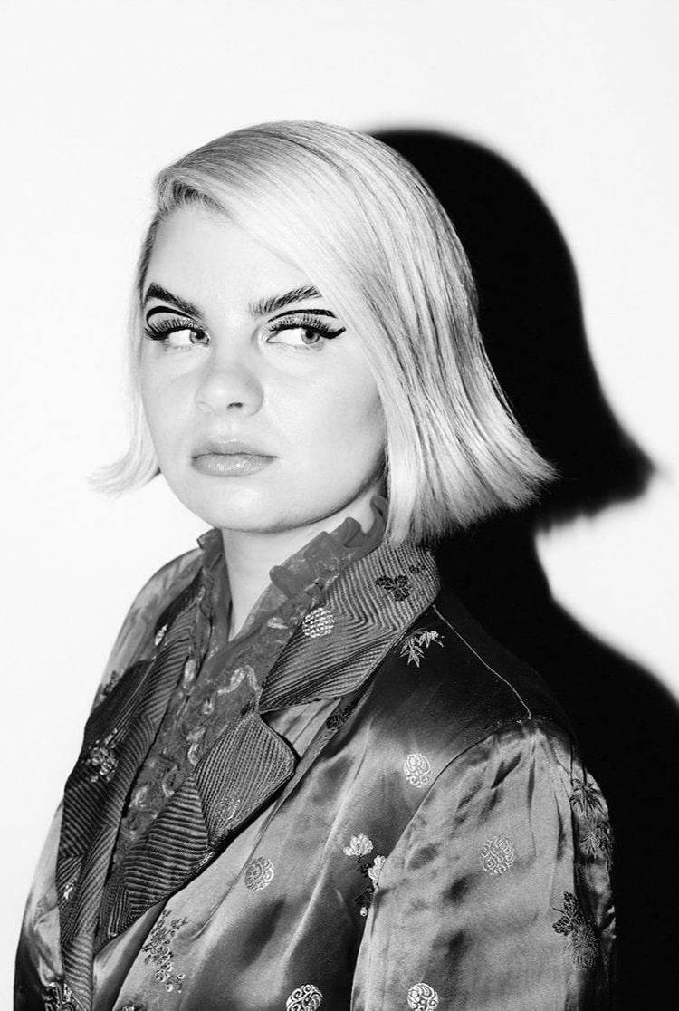 Black and white image of blonde singer