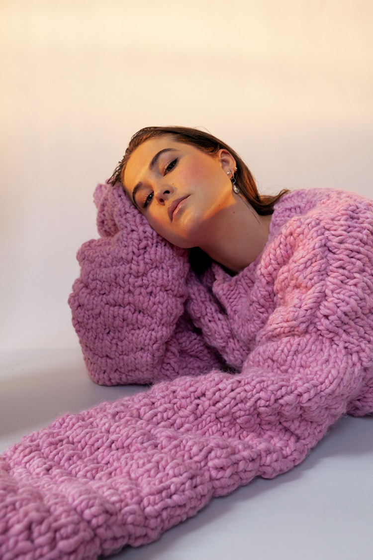 Woman in large pink wool jumper