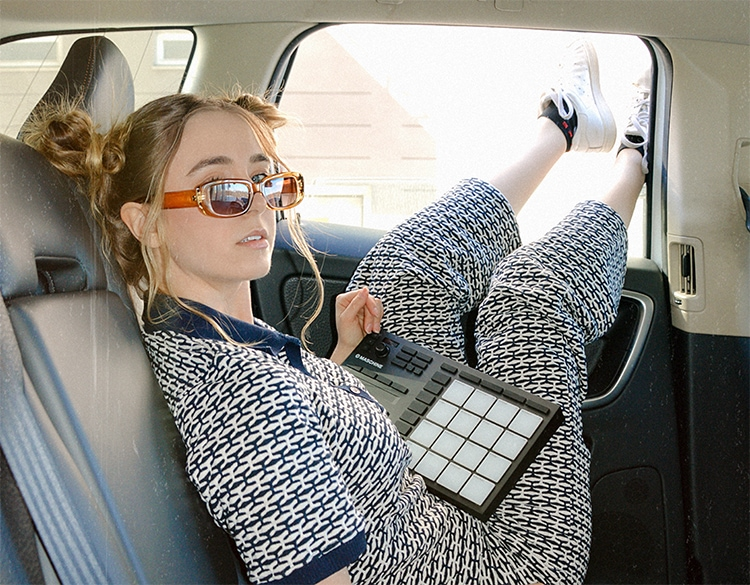 Cool girl in car legs out the window