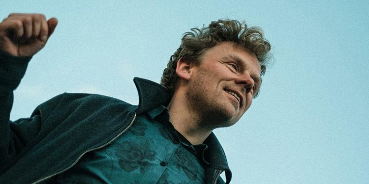 Smiling man blue sky