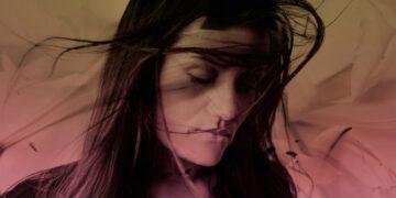 Woman in wind swirl of colour