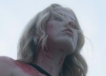 Blood covered woman