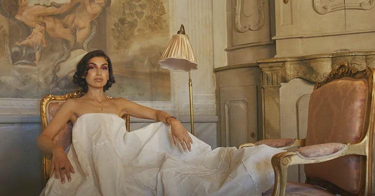 Beautiful woman in regal chair