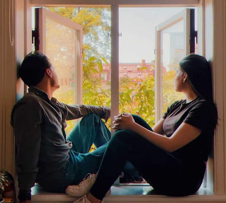 couple by open window