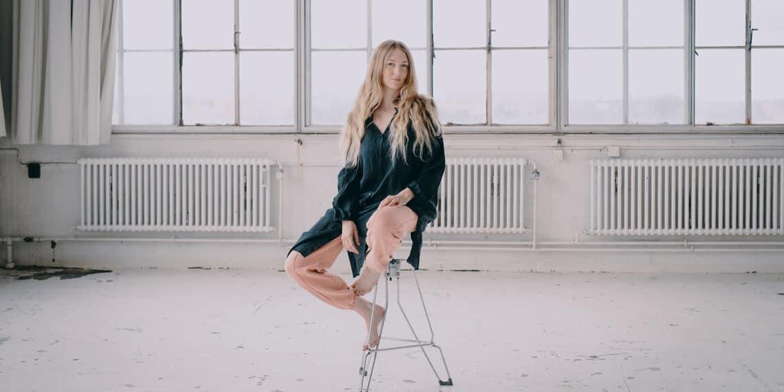 Stylish woman sitting on chair