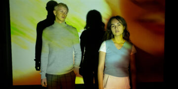 Two young people in projected light