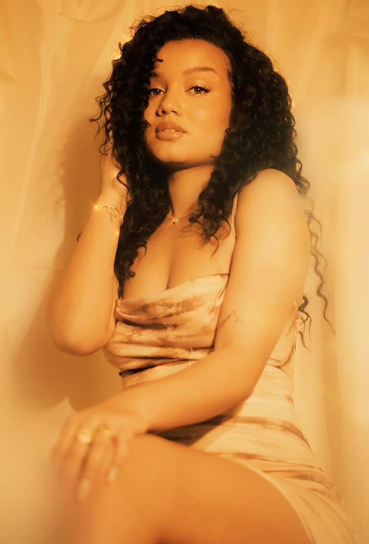 Attractive black woman in golden hue