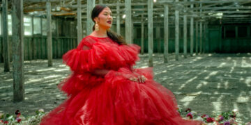 Attractive Mexican American woman in red dress
