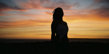 Woman in sunset silhouette